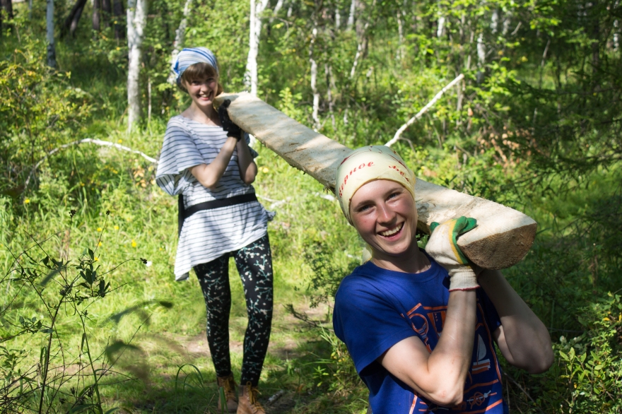 Tanya and Zhenya Carrying Wood